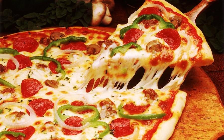 طريقة عمل بيتزا المشروم في البيت بيتزا-المشروم.jpg